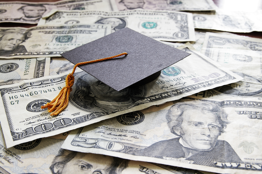 United States cash with a graduation cap on top.